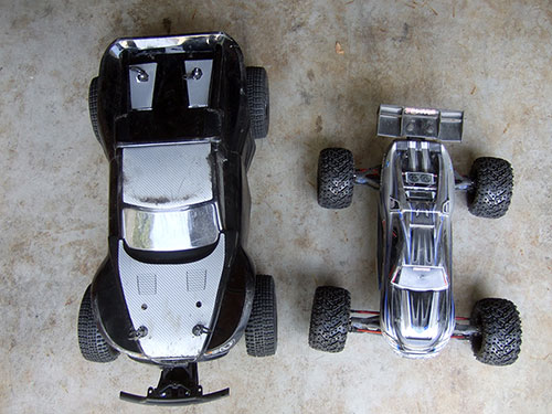 HPI Savage 5T  Super Flux-  Differential Cup Reducer / Spacer . Next to a Traxxas E-Revo
